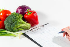 Female Nutritionist Doctor Hand Writing Diet Plan Royalty Free Stock Photo