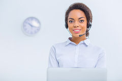 Female office employee are working with gadgets Royalty Free Stock Photos