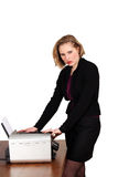 Female at office machine Stock Photos