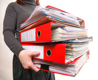 Female office worker carrying a stack of files Royalty Free Stock Photo