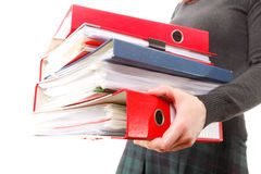Female office worker carrying a stack of files Royalty Free Stock Image
