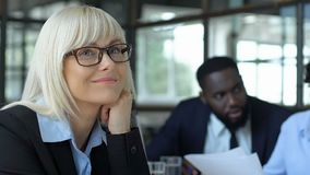 Female office worker distracted from business meeting, dreaming own startup