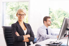Female office worker in formalwear with her colleague Stock Image
