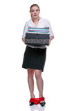 Female office worker with her hands full Royalty Free Stock Photos