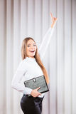 Female office worker hold case show victory sign. Stock Images