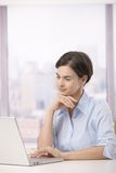 Female office worker with laptop Stock Photography