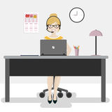 Female office worker with laptop and headphones Royalty Free Stock Image