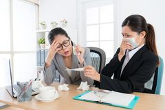 Female office worker looking at thermometer Stock Photography
