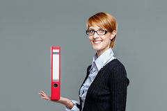 Female office worker presenting a folder on her hand Royalty Free Stock Images