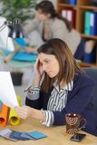 Female office worker reading document Royalty Free Stock Photography