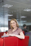 Female Office Worker Sitting On Sofa Stock Photos