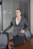 Female office worker standing in boardroom royalty free stock photos