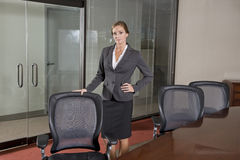 Female office worker standing in boardroom Royalty Free Stock Photography