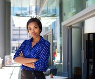Female office worker standing outside business building. Portrait of a female office worker standing outside business building Royalty Free Stock Photo