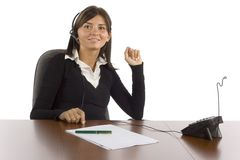Female office worker talking phone Royalty Free Stock Photo