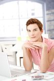 Female office worker thinking Royalty Free Stock Image