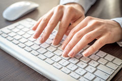 Female office worker typing. Female office worker typing on the keyboard Royalty Free Stock Photos
