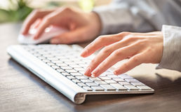 Female office worker. Female office worker typing on the keyboard Royalty Free Stock Photos