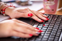 Female office worker. Female office worker typing on the keyboard Royalty Free Stock Image