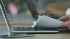Female office worker typing on laptop, woman viewing files with diagrams. Stock footage stock video footage