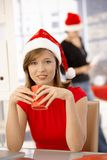 Female office worker wearing xmas hat Stock Photos