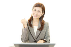 The female office worker who poses happily Royalty Free Stock Photography