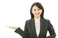 The female office worker who poses happily Royalty Free Stock Image