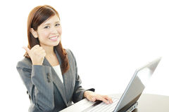 The female office worker who poses happily Stock Image