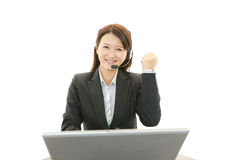 The female office worker who poses happily Royalty Free Stock Photos