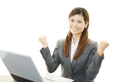 The female office worker who poses happily Royalty Free Stock Images