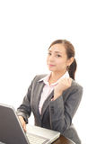 The female office worker who poses happy Royalty Free Stock Photo
