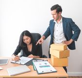 Female office worker working under pressure from supervisor. Female office worker is working under pressure from supervisor Stock Photos
