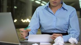 Female office worker writing notes, working on business plan, lack of ideas. Stock footage stock video footage