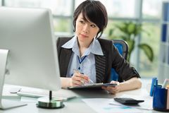 Female office worker Royalty Free Stock Image