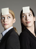 Female Office Workers With Sticky Notes On Foreheads Stock Photos