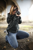 Female Officer aiming rifle Royalty Free Stock Image