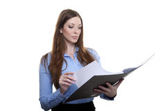 Female officer browsing in a folder Royalty Free Stock Image
