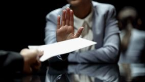 Female official refuses to take bribe, anti-corruption laws in action, close up. Stock photo royalty free stock photos