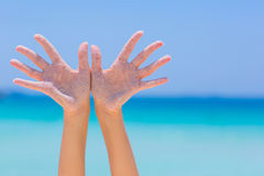 Female open hand on sea background. Female open hand on blue sea background stock images