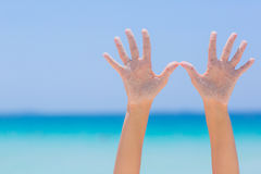 Female open hands on sea background. Female open hands on blue sea background stock photo