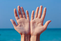 Female open hands on sea background Stock Image
