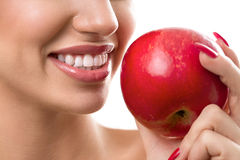 Female open mouth with perfect teeth and red apple Royalty Free Stock Photos