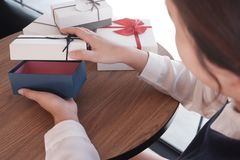 Female opening a gift box royalty free stock images