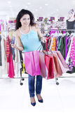 Female opens a shopping bag in the store Royalty Free Stock Photo