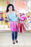 Female opens shopping bags in the fashion boutique Stock Images