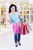 Female opens shopping bags in the fashion center Stock Image