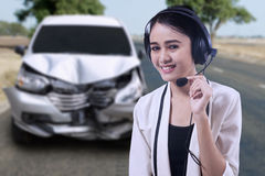 Female operator with a broken car Stock Photography