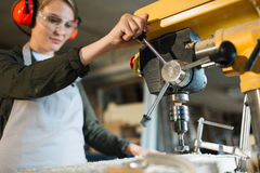 Female operator of drill press Royalty Free Stock Images