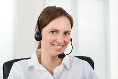 Female Operator With Headset Royalty Free Stock Photography