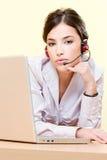 Female operator near computer Royalty Free Stock Image